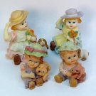 4 figurines of children small resin hand painted