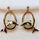 vtg Avon earrings clip dolphin rhinestone eye gold tone