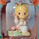 Precious Moments Christmas Ornament 266094 1996 girl wrapping a present Home for the Holidays