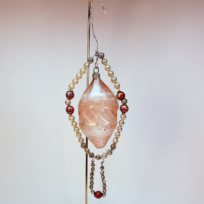 antique glass bead ornament with blown glass center pink
