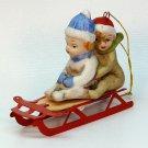 vintage Ron Gordon Christmas ornament bisque children on sled 1984