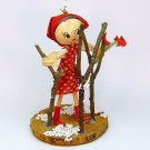 Vintage ornament girl in garden Christmas hand crafted on wood slice