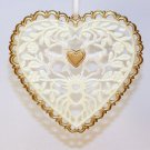 plastic heart shaped filigree Christmas ornament with flowers leaves and deer