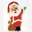 Vintage Christmas Santa plastic popcorn decoration waving and holding a toy bag