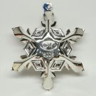Silver plate 2002 snowflake Christmas ornament with an M logo or initial