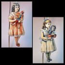 2 Victorian style Christmas ornaments laminated wood girls with dolls