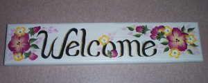 welcome sign with burgundy & small yellow flowers