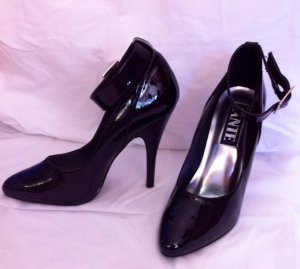 Black patent pumps with ankle strap