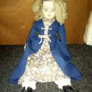 Porcelain doll with soft body - unknown age