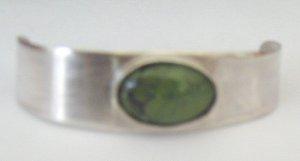 silver bracelet w/ green turquoise oval stone