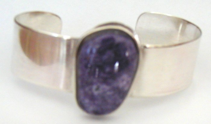 silver bracelet with large purple stone