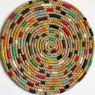 Circular wall hanging. Circle round decoration. Textile art or fiber rope modern