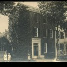 Early 1900's AZO Real photo postcard Ivy covered brick home with kids
