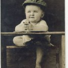 Cute baby at desk studying  Real Photo postcard hand colored early1900 W43