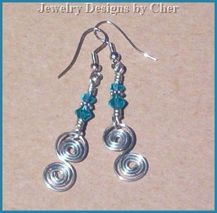 SWAROVSKI BLUE ZIRCON Silver Spiral Earrings