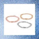 Set of three simulated diamond triple strand bracelets.
