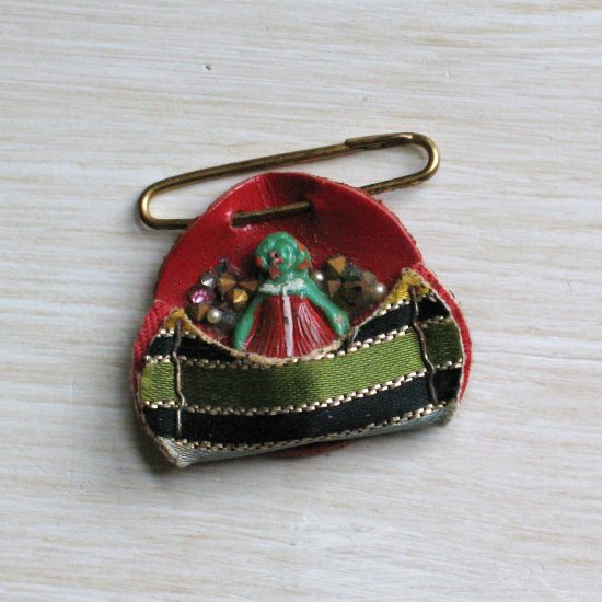 tiny green handpainted celluloid doll pin with rhinestones and leather - vintage jewelry