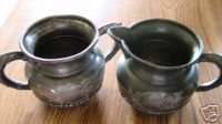 SUPERIOR QUADRUPLE SILVER PLATE CREAM AND SUGAR SET