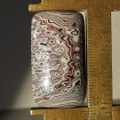Fordite cabochon, 34X19mm rectangle