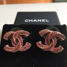 CHANEL Rose Gold Pink Twisted Crystal Stud Earrings CC Hallmark Authentic