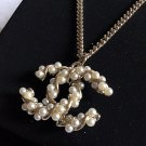 CHANEL Pearl Twisted CC Pendant Gold Metal Chain Necklace Hallmark NIB
