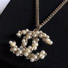 CHANEL Pearl Twisted CC Pendant Gold Metal Chain Necklace Hallmark NIB