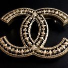 CHANEL Pale Gold Hollow Patterned Metal Brooch Pin Vintage Style