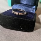 Tiffany & Co. 18kt white gold band ring with 3 diamonds