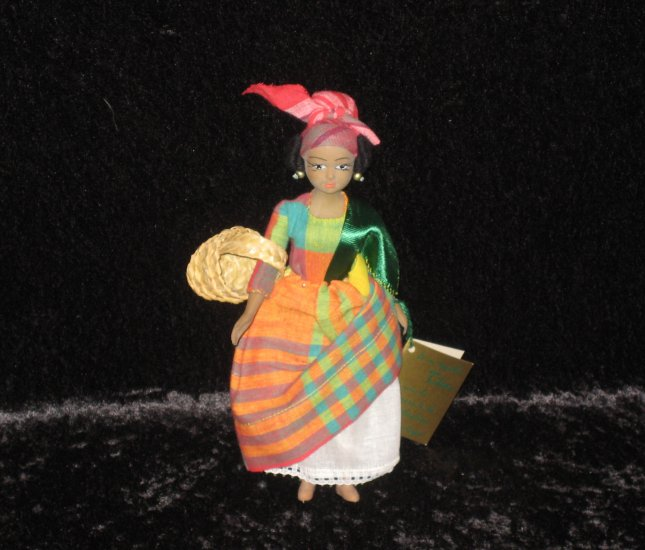 Older plastic french doll, dressed in autenthic Caribbee costume