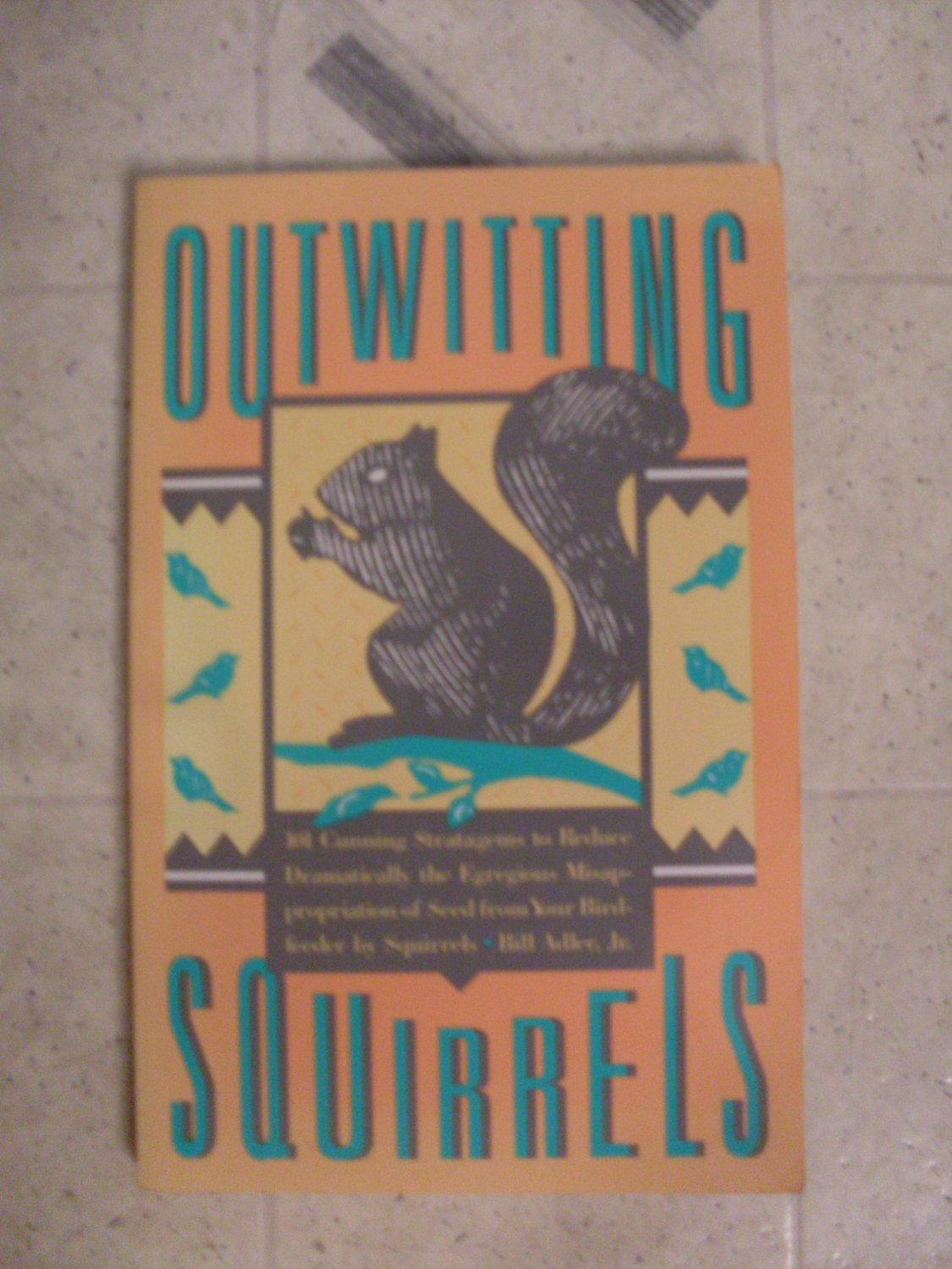 Outwitting Squirrels book protect your bird feeders