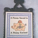 VINTAGE CAST IRON TRIVET WITH TILE ~A PENNY SAVED IS A PENNY EARNED PIGGY ~GEORGE GOOD 1983