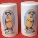 PREMIUM CRACKERS BOY IN YELLOW RAINCOAT SALT AND PEPPER SHAKERS SET --UNUSED~NEW~ADVERTISING