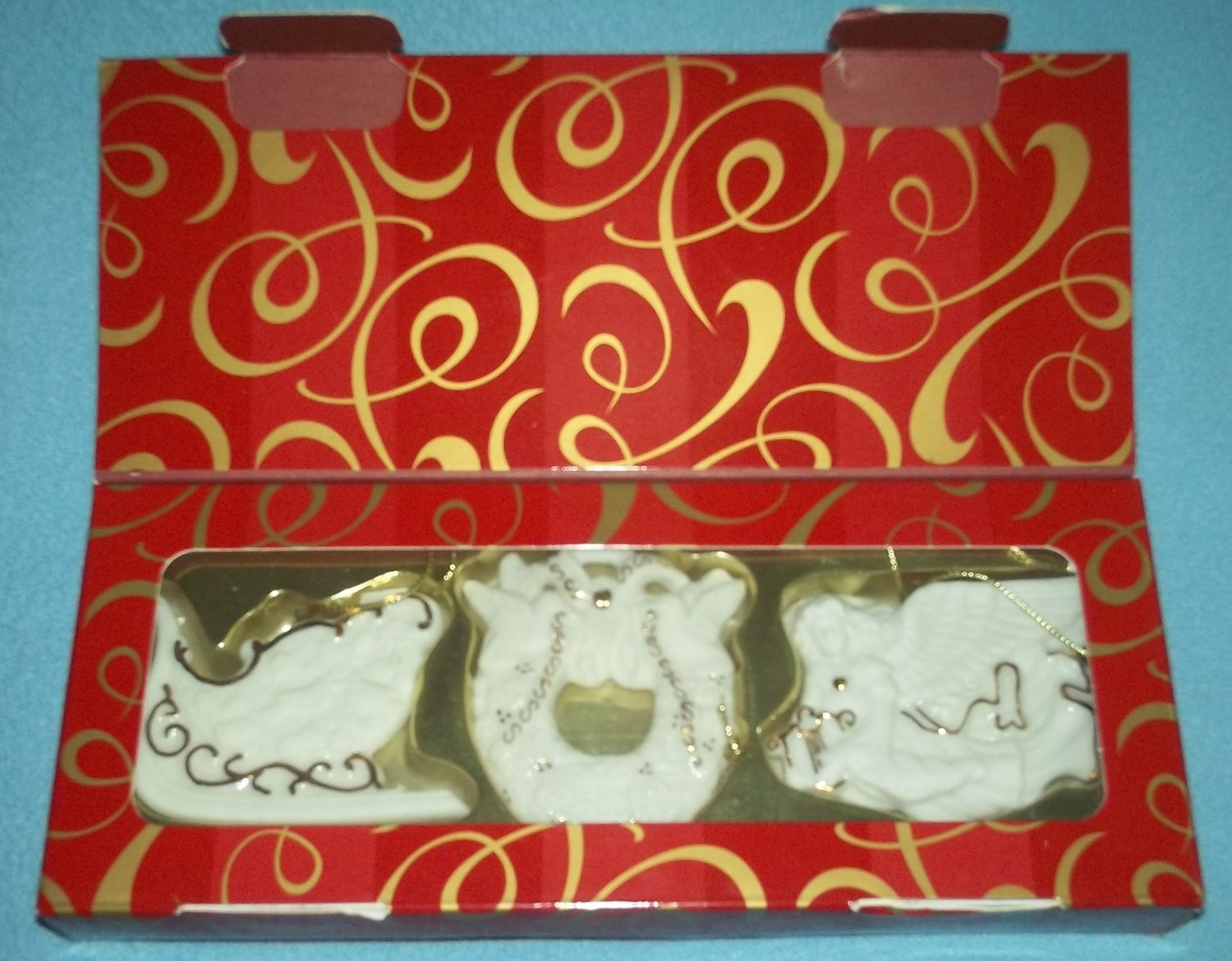 AVON CHRISTMAS ORNAMENTS BISQUE 24 kt gold 2001 ANGEL WREATH SLED