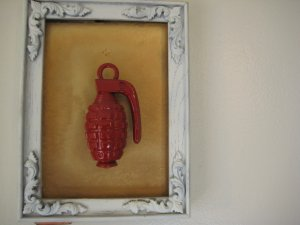 red grenade on gold and white