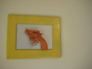 orange gun on silver and yellow