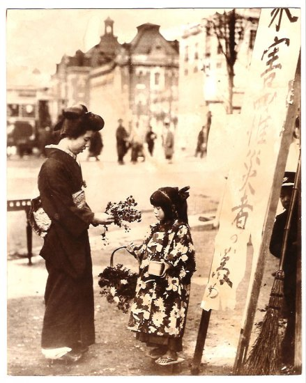 Real Photo of a Japanese woman and flower girl in the early 1900's