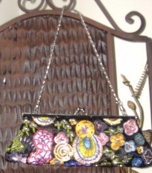 $16**black & multi-colored embellishment clutch