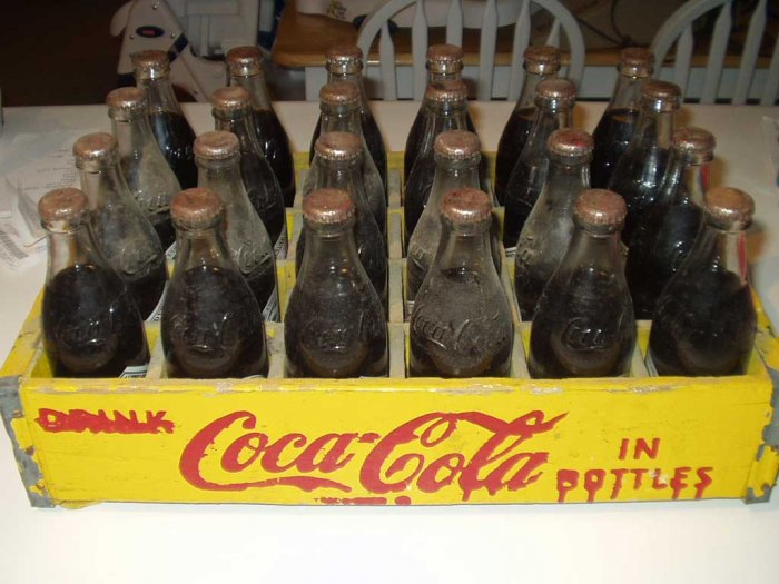 24 Unopened 75th Ann. Coca Cola Bottles In Yellow Crate