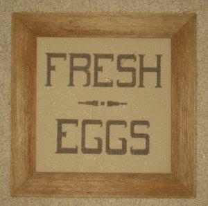 Framed stitched piece in barnboard frame
