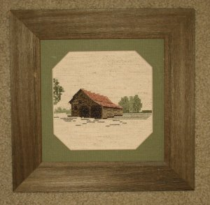 Framed stitched piece in barnboard frame