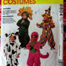 McCalls Pattern # 6804  UNCUT Toddlers Costume Size 1 2 3 Clown Flower Cow Dinosaur