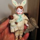 """4"""" All Bisque Antique German Baby Boy doll in bunny outfit and teddy bear"""
