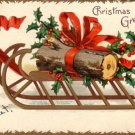 Yule Log on Sled Christmas Greetings by Ellen H. Clapsaddle, 1907 Vintage Postcard - 3785