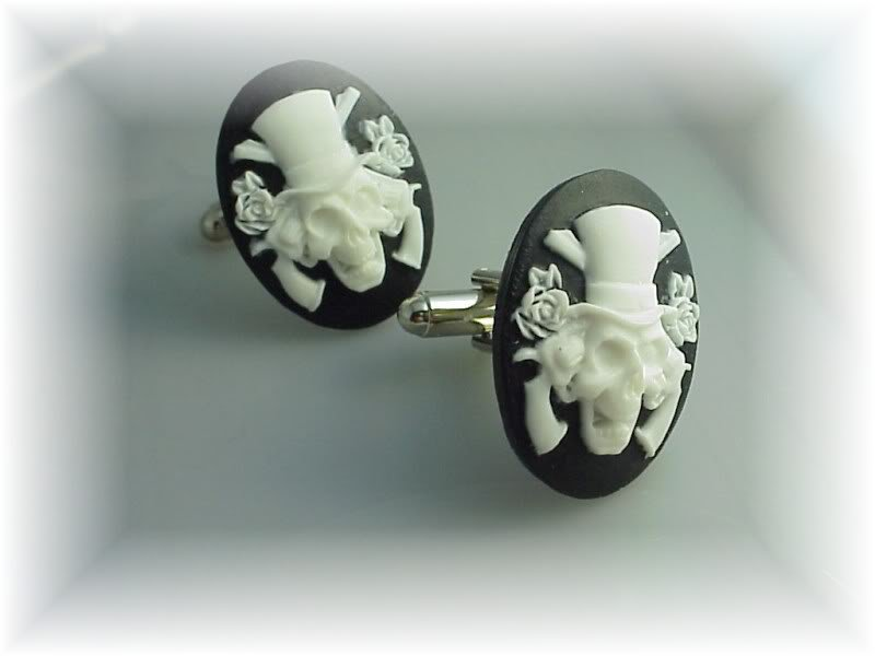 Phyl's cufflinks Guns and Roses goth steampunk