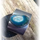 Bluish green agate slice with geode crystals on silvery cuff bracelet
