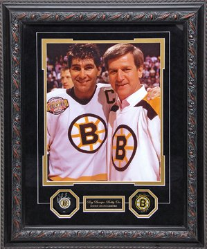 BOBBY ORR - RAY BOURQUE AUTOGRAPHED PUCKS IN SHADOWBOX