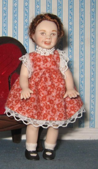 miniature porcelain dollhouse doll child