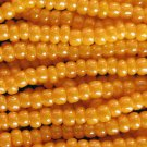 11/0 CZECH GLASS SEED BEADS LUSTER ORANGE 1 HANK