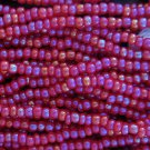 11/0 CZECH GLASS SEED BEADS AURORA BOREALIS DARK RED 1 HANK
