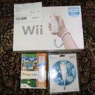 NIntendo Wii w/14 Games + 4 Remotes